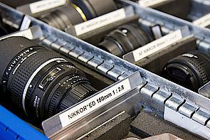 Kameraobjektive in einer Schachtel